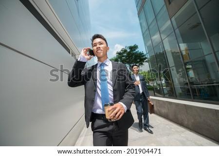 Young businessmen going to the work in the morning - stock photo