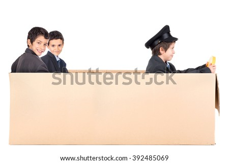 Young businessmen in cardboard box limousine with driver - stock photo