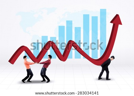 Young businessmen lifting up a business graph with world map background - stock photo