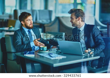 Young businessmen planning work and discussing new project - stock photo