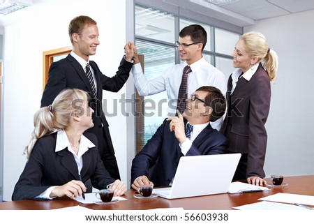 Young businessmen rejoice in the success of the office - stock photo