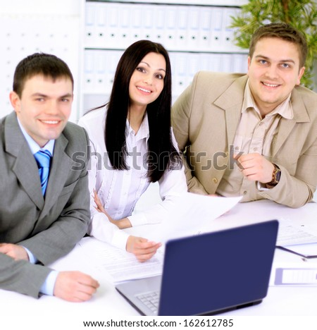 Young businesspeople discuss the new project at office. - stock photo