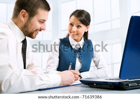 Young businesspeople discuss the new project at office - stock photo