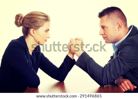 Young businesspeople fighting on hands - stock photo
