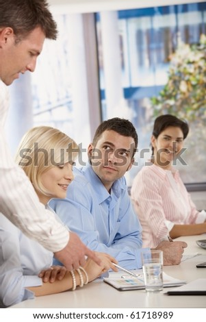 Young businesspeople having business meeting in office boss explaining giving instructions.? - stock photo
