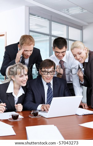 Young businesspeople in an office happy success - stock photo