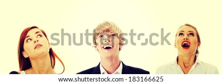 Young businesspeople looking up - stock photo