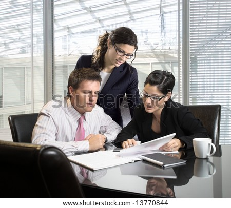 Young businesspeople on a meeting - stock photo