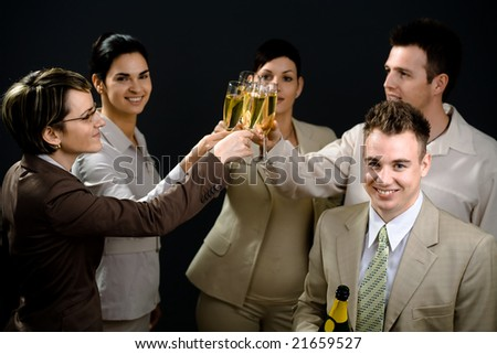 Young businesspeople on New Year Eve Party. - stock photo