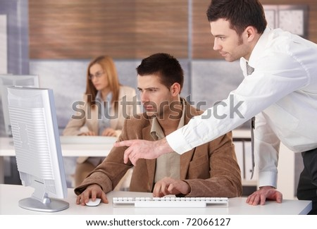 Young businesspeople participating at computer course.? - stock photo