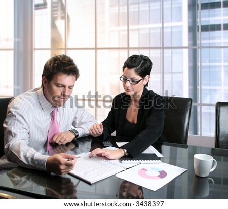 Young businesspeople work with documents and charts in the meeting room. - stock photo