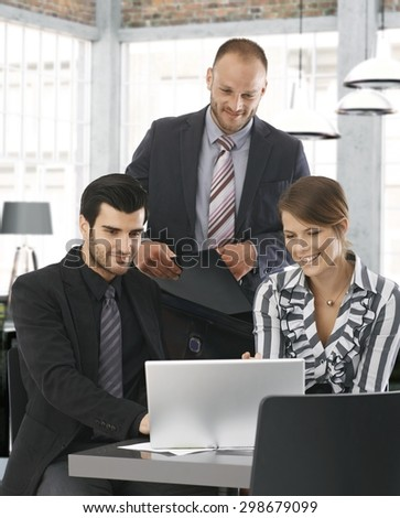 Young businesspeople working together in office. - stock photo
