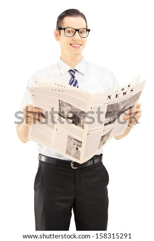 Young businessperson holding a newspaper and looking at camera isolated against white background - stock photo