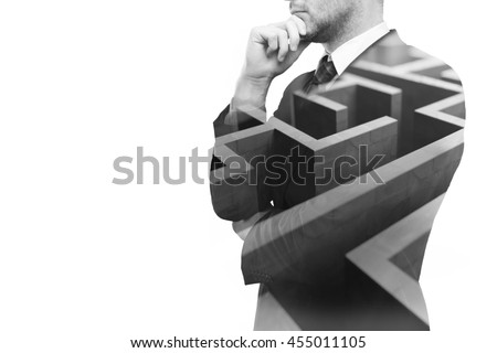 Young businessperson thinking about ways to overcome business obstacle. Isolated on white background with maze and copy space. Double exposure - stock photo