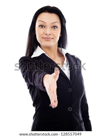 Young businesswoman about to shake hands in full length pose, isolated over white background - stock photo