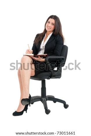 Young businesswoman accounting and sitting on a chair isolated over white - stock photo