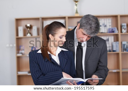 Young businesswoman and businessman in office, teamwork - stock photo