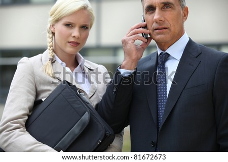 Young businesswoman and director looking worried - stock photo
