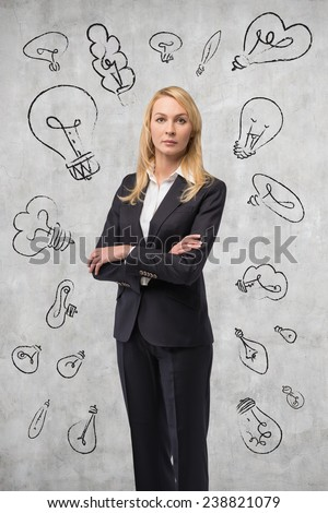 young businesswoman and drawing lamps on wall