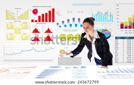 Young businesswoman and statistics information on table - stock photo