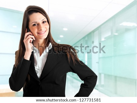 Young businesswoman at phone