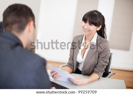 Young businesswoman at the hiring interview in the office - stock photo