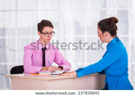 Young businesswoman at the hiring interview in the office.A woman manager looking at interview during conversation.Job interview.Job applicant having an interview - stock photo