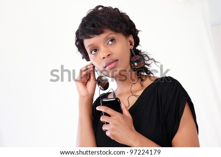 Young businesswoman busy on smart phone