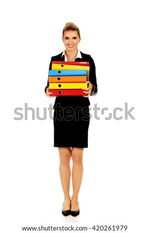 Young businesswoman carries heavy binders
