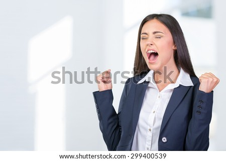 Young businesswoman celebrating success - stock photo