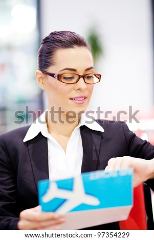 young businesswoman checking her flight time at airport