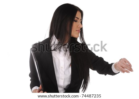 young businesswoman checks time on her wrist watch - stock photo