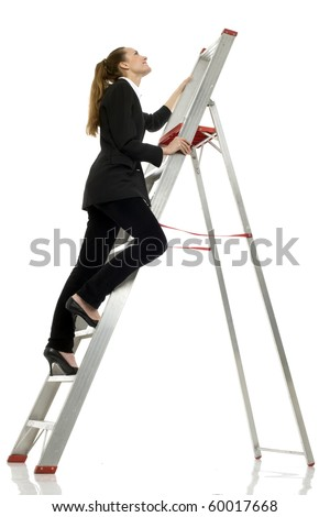 young businesswoman climbing a ladder on white background studio - stock photo