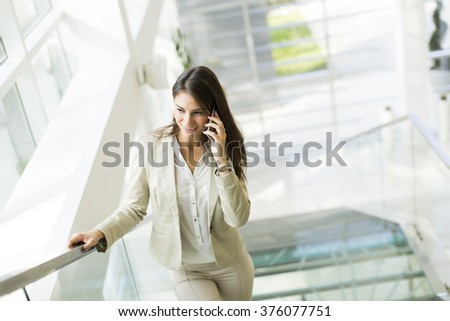 Young businesswoman climbs the stairs