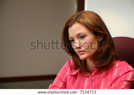 Young businesswoman closeup in an office setting - stock photo