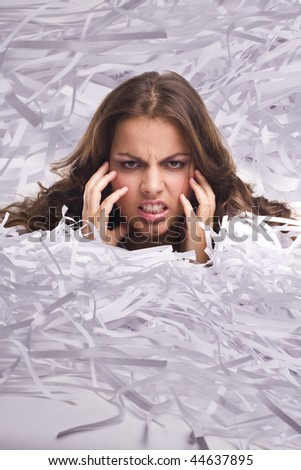 Young Businesswoman covered by shredded papers