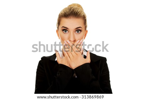 Young businesswoman covering with hand her mouth. Speak no evil concept. - stock photo