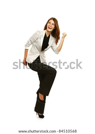 Young businesswoman dancing with YES gesture, isolated on white