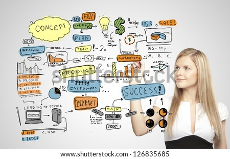young businesswoman drawing business plan - stock photo