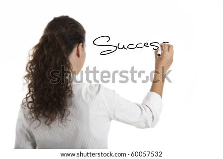 Young businesswoman drawing the word sucess, isolated on white background - stock photo