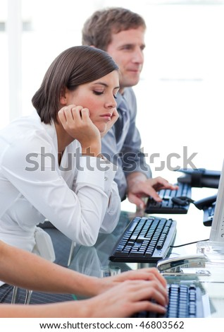 Young businesswoman getting bored at work in a company
