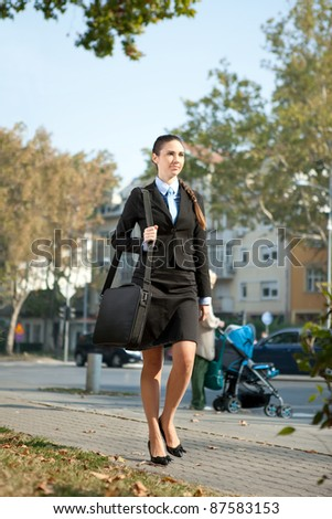 young  businesswoman going on work - stock photo