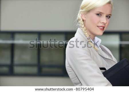 Young businesswoman going to work - stock photo