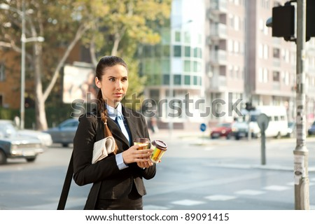 young businesswoman going to work with coffee in hand,  concept-business morning outdoor - stock photo