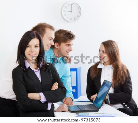 young businesswoman happy smile at office, colleagues on background people working, business man and woman discussing talking, businesspeople communicating