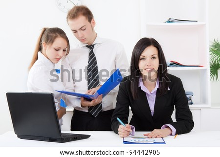 young businesswoman happy smile looking at camera at office, businesspeople colleagues on background people working, business man and woman discussing the problem, business plan, papers document - stock photo