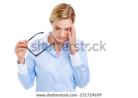Young businesswoman has splitting headache pain migraine - stock photo
