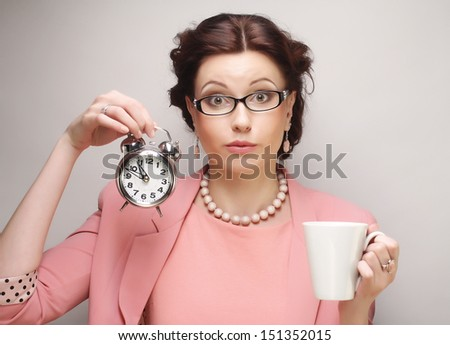 Young businesswoman having a coffee-break - stock photo