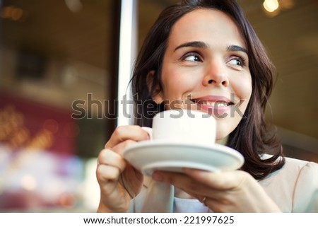 Young Businesswoman Having a Coffee Break. - stock photo
