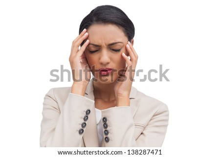 Young businesswoman having a headache on white background - stock photo